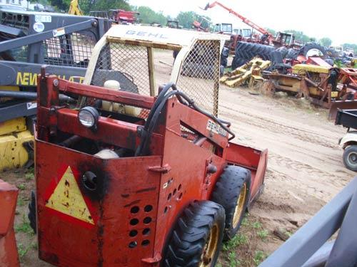 Used Gehl 2600 skid steer loader parts. Rear photo EQ-18937