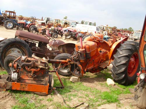 Allis Chalmers D17 tractor salvaged for used parts. This unit is available at All States Ag Parts in Black Creek, WI. Call 877-530-2010 parts. Unit ID#: EQ-19272. The photo depicts the equipment in the condition it arrived at our salvage yard. Parts shown may or may not still be available. http://www.TractorPartsASAP.com