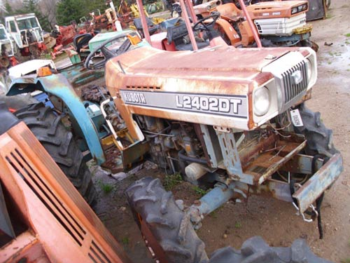 Kubota L2402 tractor salvaged for used parts. This unit is available at All States Ag Parts in Black Creek, WI. Call 877-530-2010 parts. Unit ID#: EQ-21227. The photo depicts the equipment in the condition it arrived at our salvage yard. Parts shown may or may not still be available. http://www.TractorPartsASAP.com
