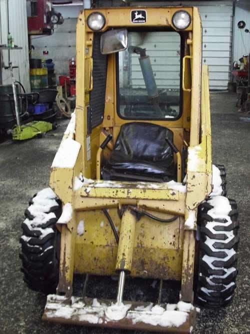 Used John Deere 570 skid steer loader parts. Front photo EQ-21804