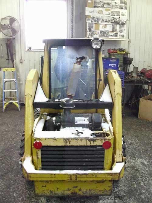 Used John Deere 570 skid steer loader parts. Rear photo EQ-21804