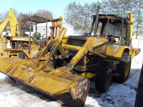 John Deere 410B industrial salvaged for used parts. This unit is available at All States Ag Parts in Black Creek, WI. Call 877-530-2010 parts. Unit ID#: EQ-21839. The photo depicts the equipment in the condition it arrived at our salvage yard. Parts shown may or may not still be available. http://www.TractorPartsASAP.com