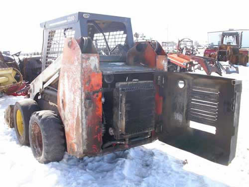 Used Scat Trak 1300C skid steer loader parts - front photo EQ-21879