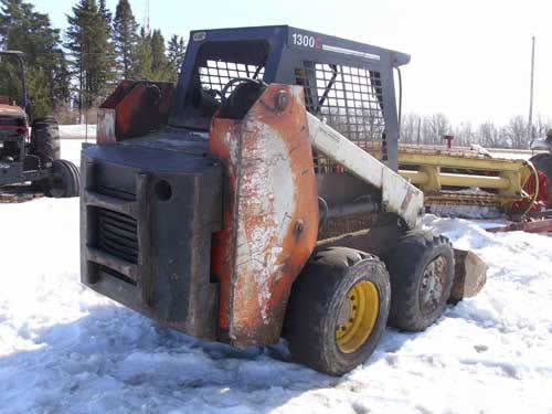 Used Scat Trak 1300C skid steer loader parts - rear photo EQ-21879