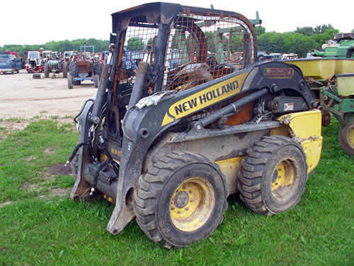 New Holland L220 skid steer salvaged for used parts. This unit is available at All States Ag Parts in Black Creek, WI. Call 877-530-2010 parts. Unit ID#: EQ-22488. The photo depicts the equipment in the condition it arrived at our salvage yard. Parts shown may or may not still be available. http://www.TractorPartsASAP.com