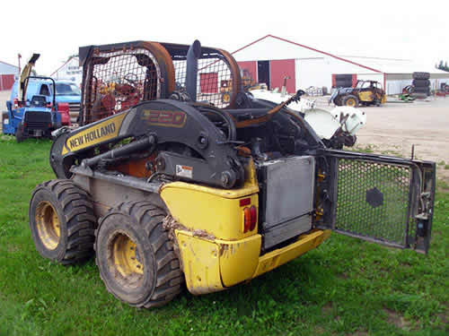 Used New Holland L220 skid steer loader parts. Front photo EQ-22488